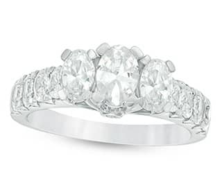 Diamond engagement ring in 10K white gold with three diamond settings.