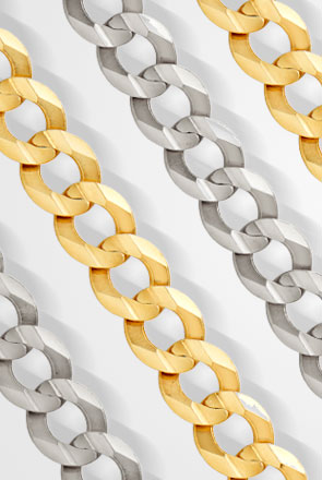Pictured are gold curb chains against a white background.
