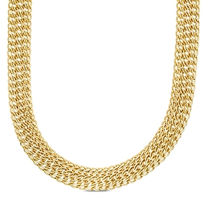 Pictured is a gold curb chain against a white background.