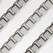 Pictured are white gold box chains against a white background