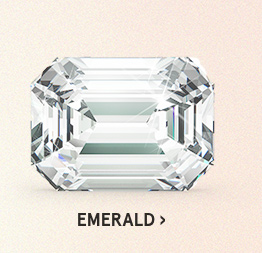 Image of an emerald diamond cut on a light pink background.