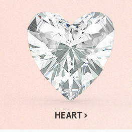 Image of a heart diamond cut on a pink background.