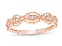A rose gold diamond art deco vintage-style anniversary ring
