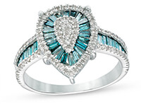 A white gold, pear-shaped statement ring surrounded by blue topaz gemstones