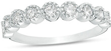 A platinum ring with a number of round shaped diamonds on the band