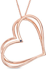 A pair of rose gold hearts on a rose gold chain