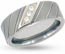 A tungsten wedding band with three small stones set diagonally
