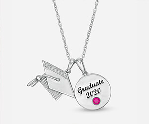A silver chain with a graduation cap pendant and a personalized pendant that says 'Graduate 2020' above a rose colored gemstone