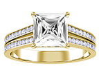 A yellow gold channel engagement band with a princess cut center stone