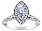 A platinum engagement band with numerous smaller diamonds surrounding a marquise cut center stone