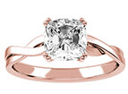 A rose gold split shank engagement ring band with a radiant cut center stone