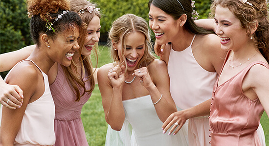 A bride-to-be surrounded by her bridesmaids