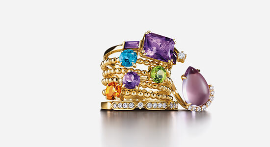 A stack of rings showing a wide variety of gemstones