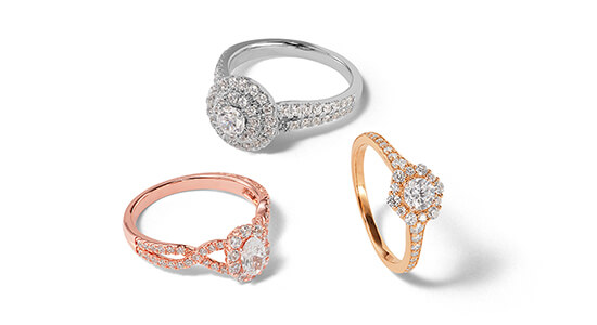 Silver, rose gold and yellow gold engagement rings with round and oval shaped center stones