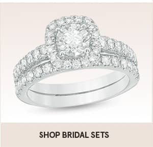 Shop bridal sets with shopping link. Zales engagement ring shows bridal sets and this image is two diamond bands and one main center diamond with diamonds around the main stone.
