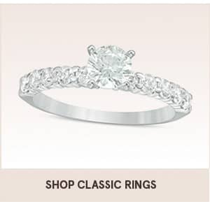 Shop classic rings with the shopping link. The image shows a diamond ring with diamonds on the band.