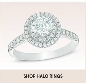 Shop halo rings with shopping link. The image shows a halo ring with two circles of diamonds around the center diamond.