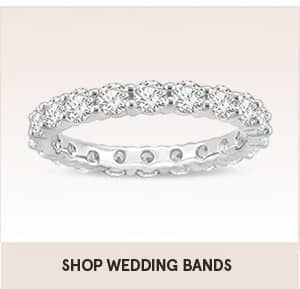 Shop wedding bands from the link on this picture. Image shows an eternity wedding band with diamonds all the way around the ring.